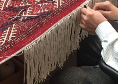 Repairing fringe on bokhara rug