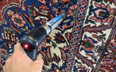 Using a moisture probe in rug washing