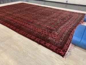 Wool afghan rug tacked down