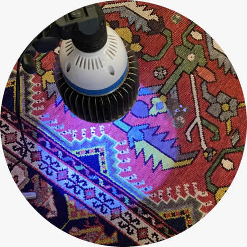 Stain removal with UV light on oriental rug