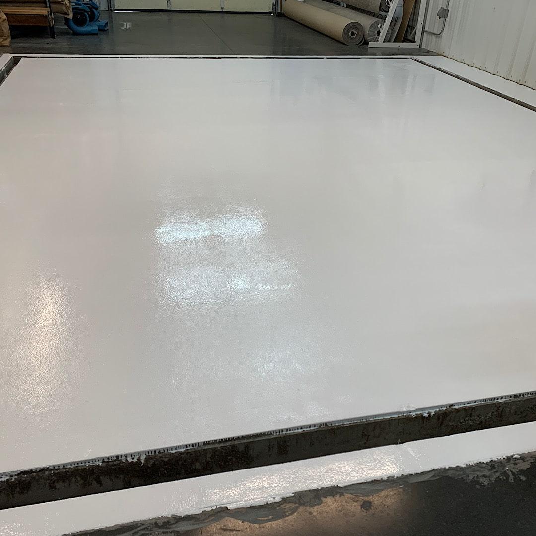White epoxy rug washing floor